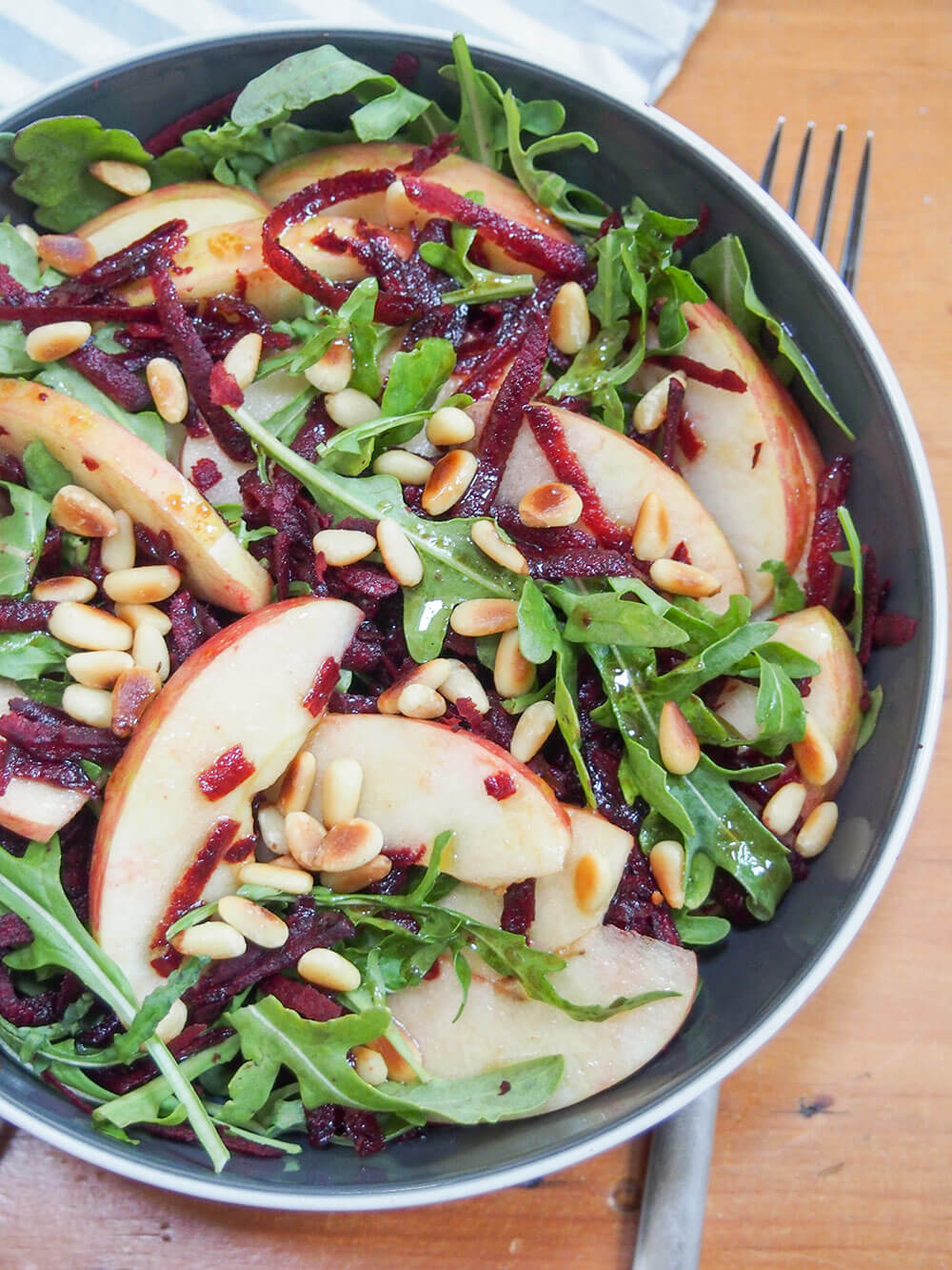 beet apple salad with maple vinaigrette with fork under bowl