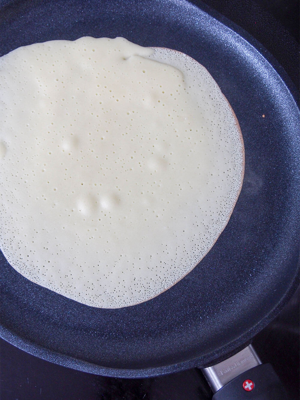 making crepes for apple crepes