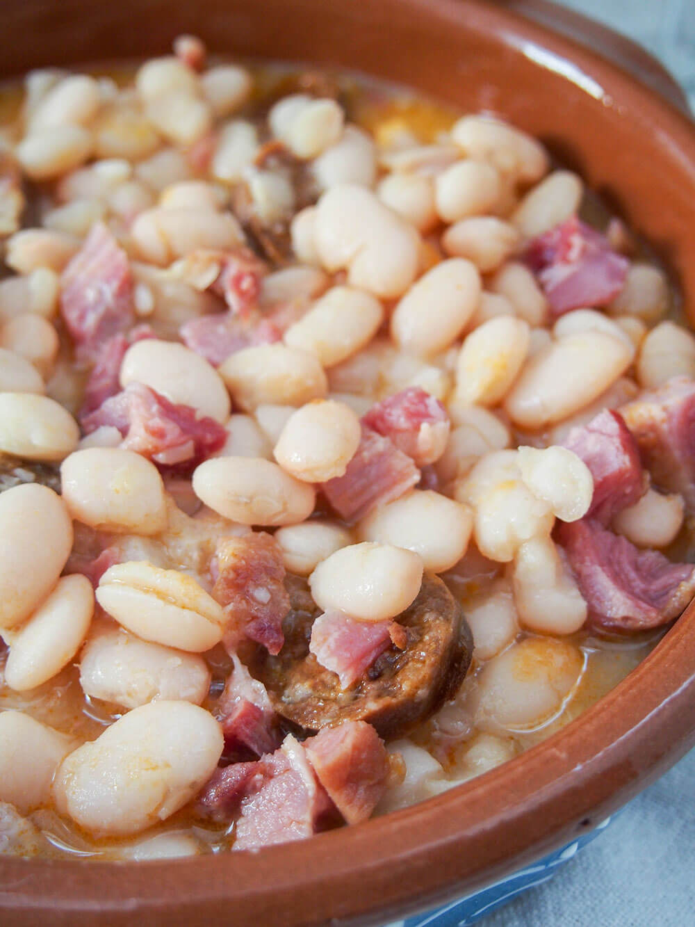 Fabada Asturiana - Asturian white bean stew close up