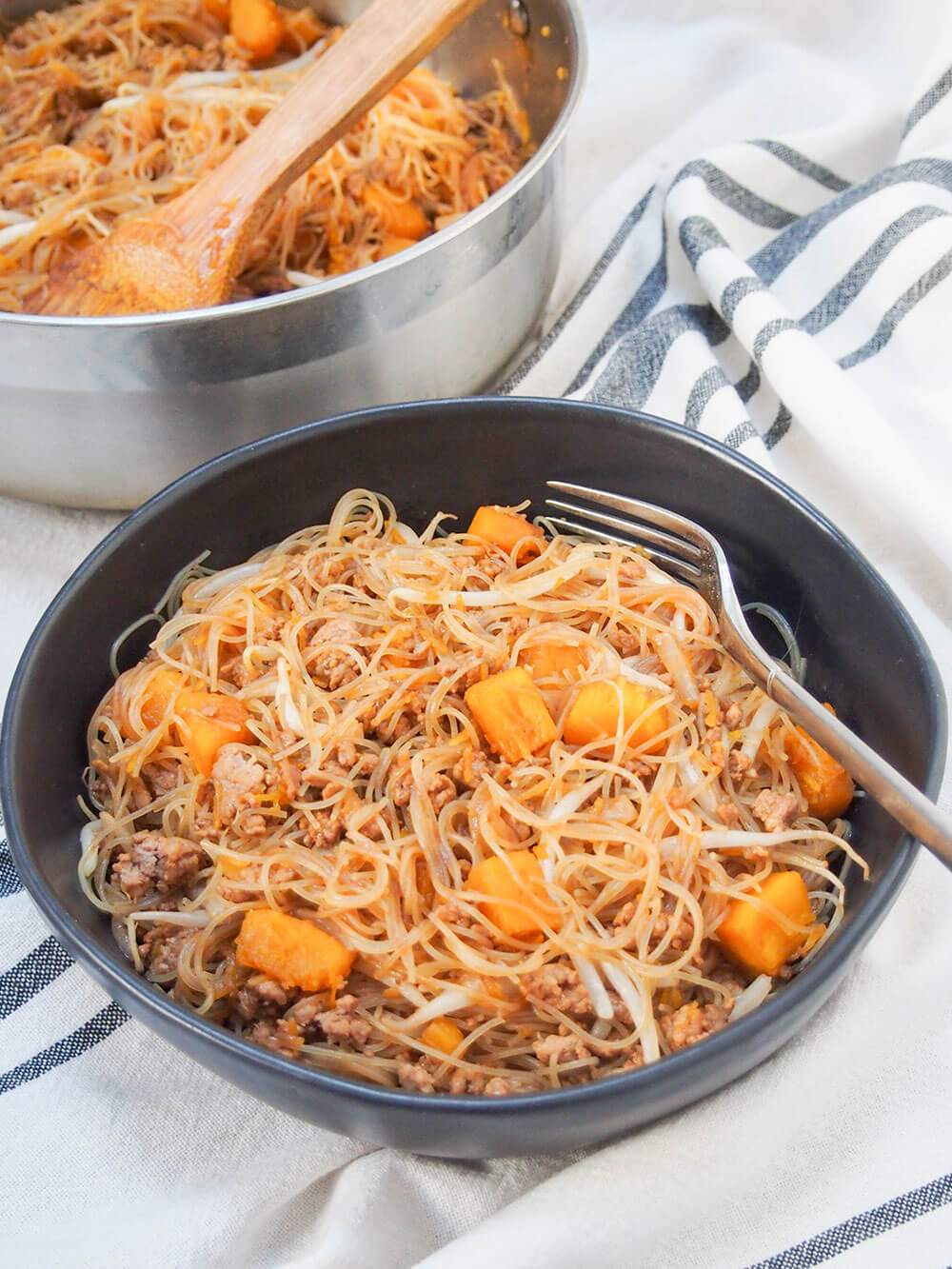 Taiwanese pumpkin rice noodles part in bowl and part in pan