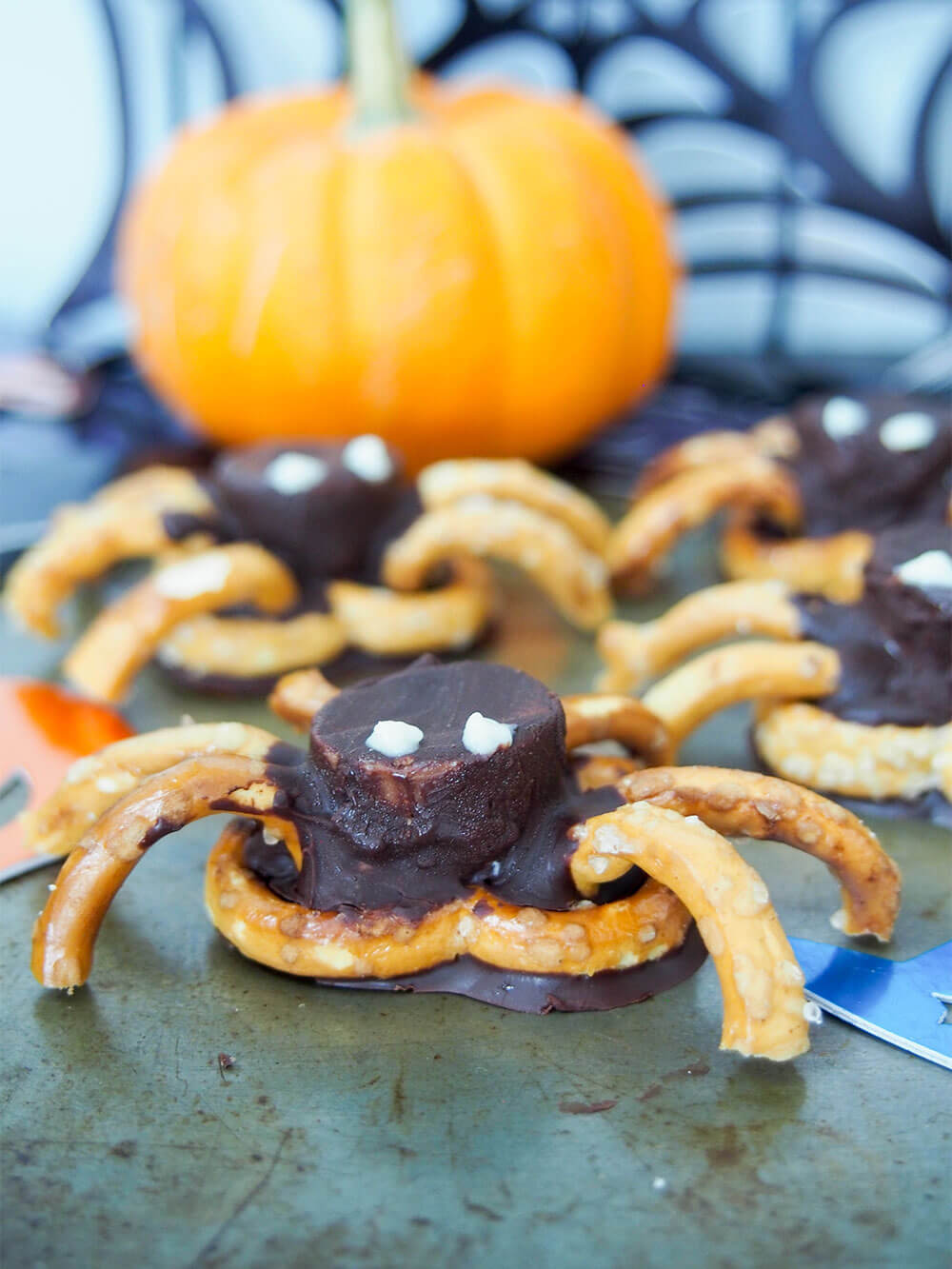 These chocolate pretzel spiders are the perfect fun snack for your next Halloween party! Easy enough for the kids to help make and a tasty sweet-salty mix.