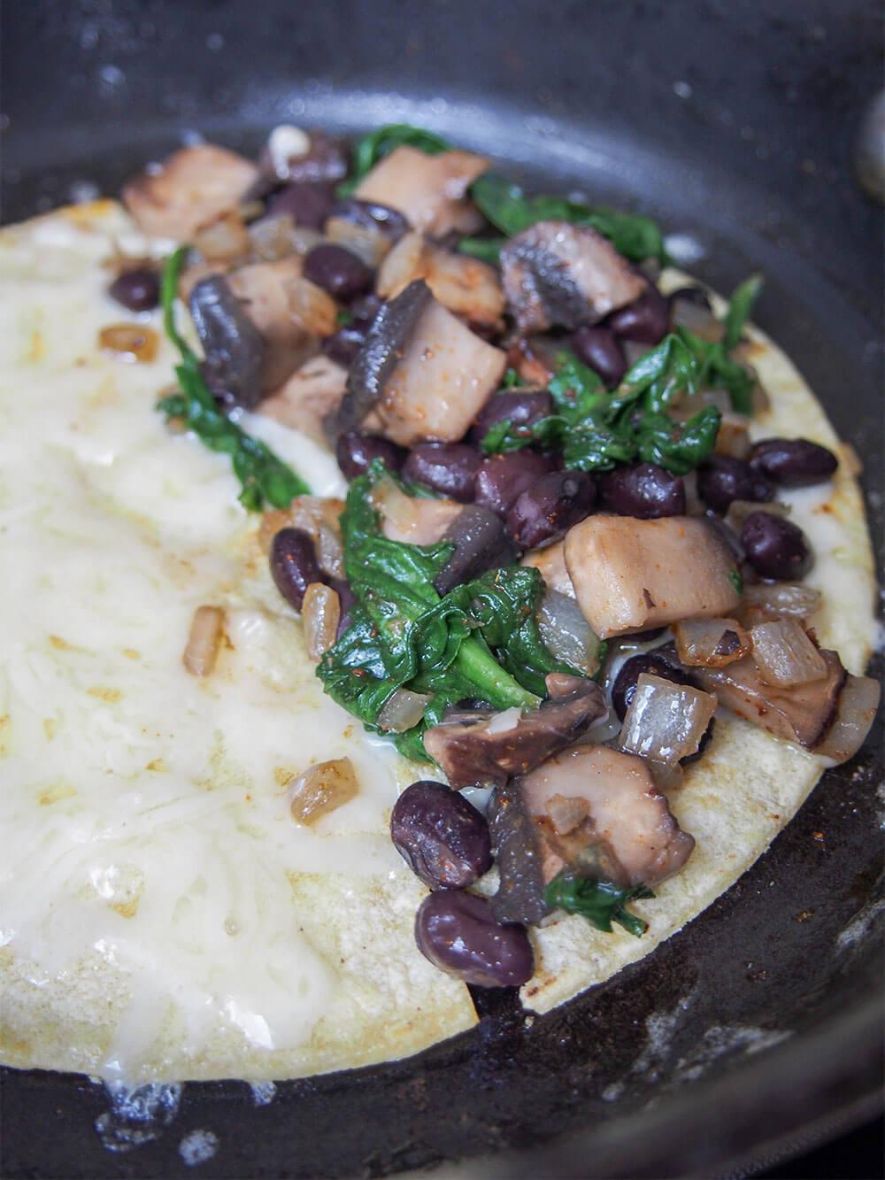 making mushroom quesedillas