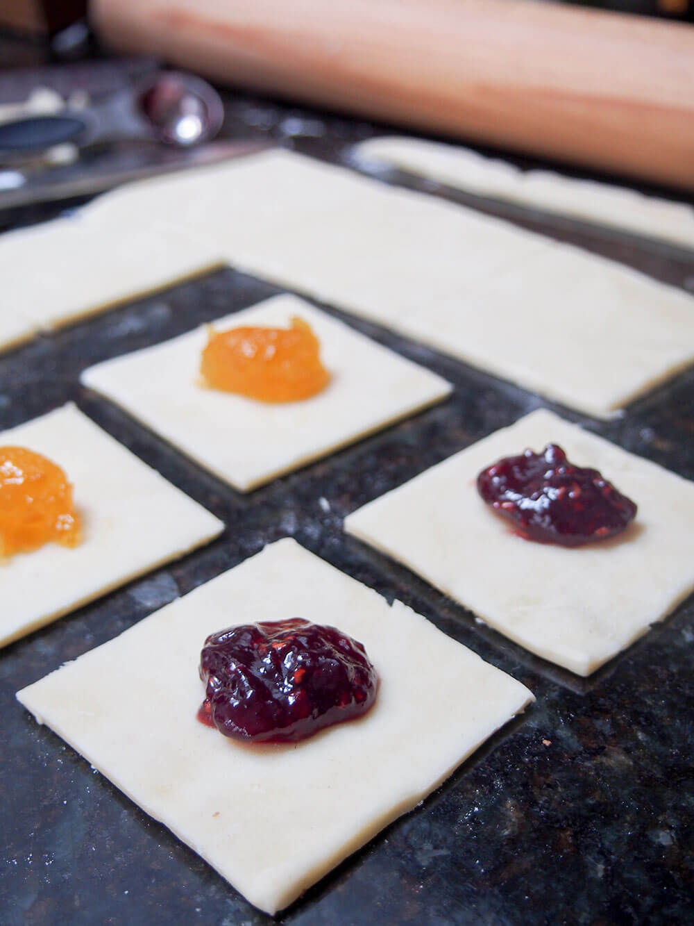 adding jam filling to kolache cookies
