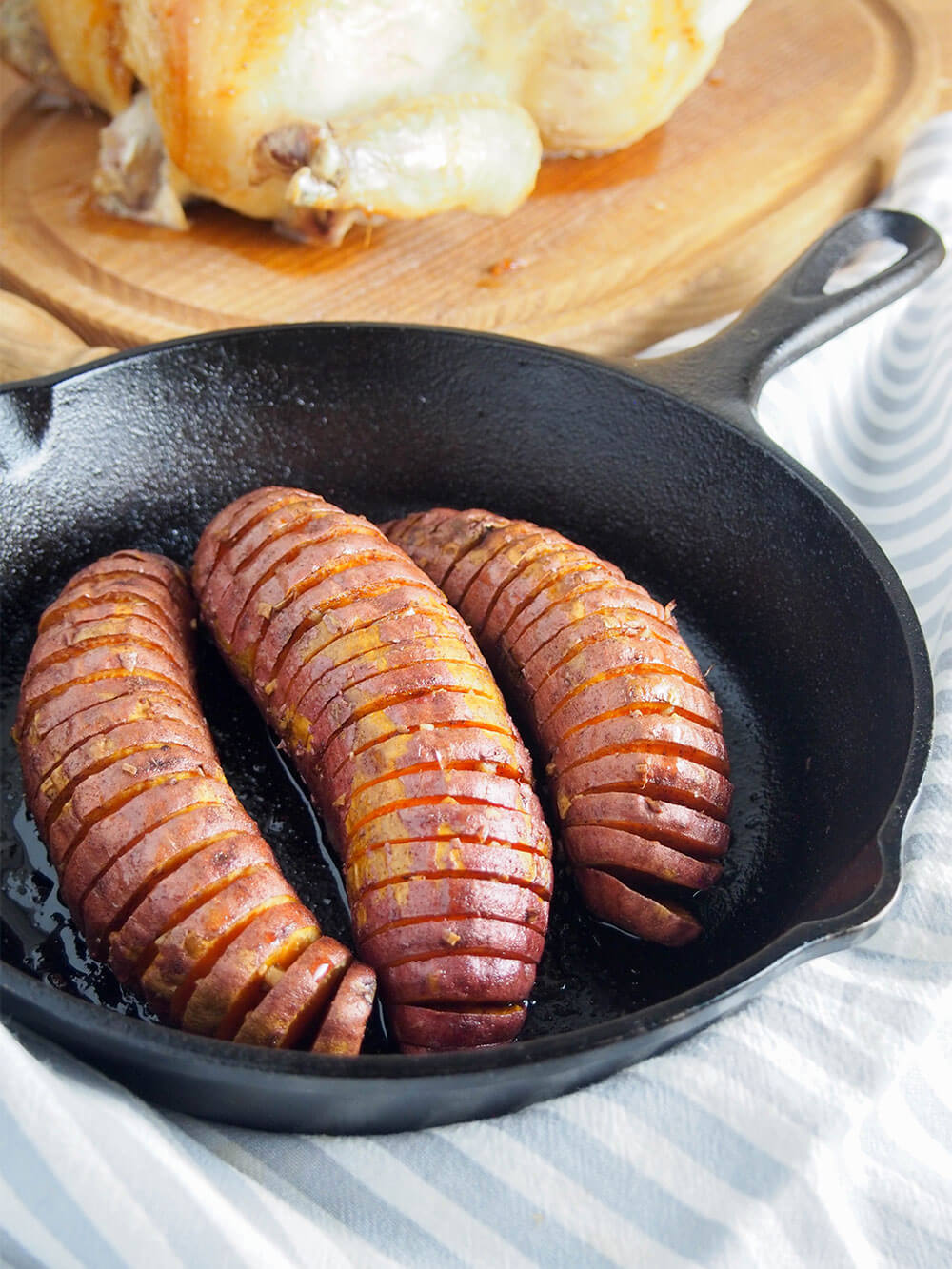 hasselback sweet potatoes here serves as a side to roast chicken