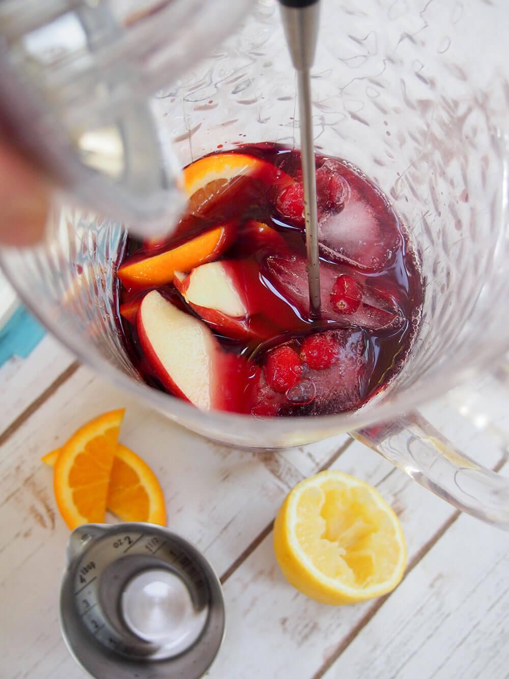 mixing cranberry sangria
