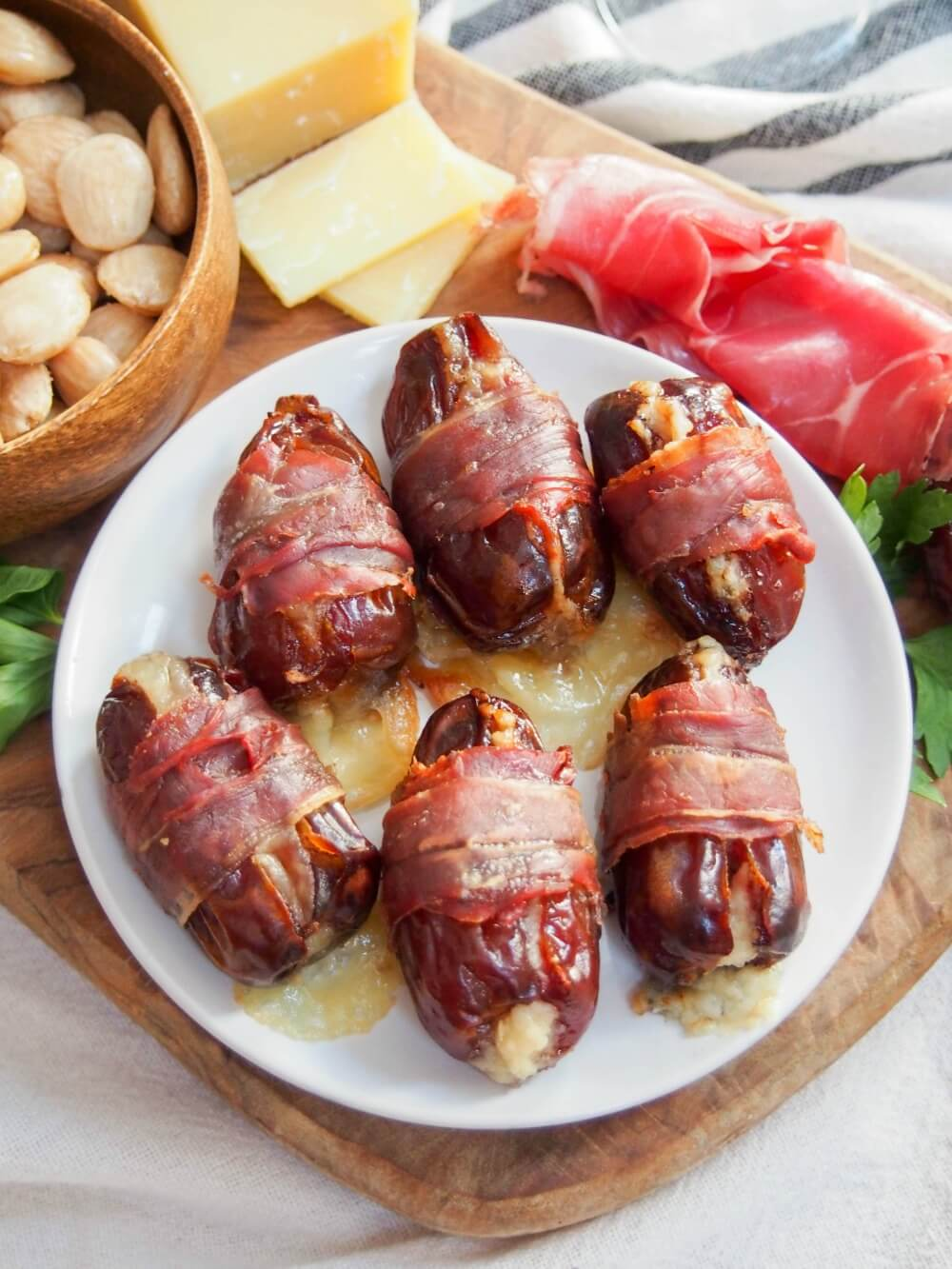 prosciutto wrapped dates on plate from above