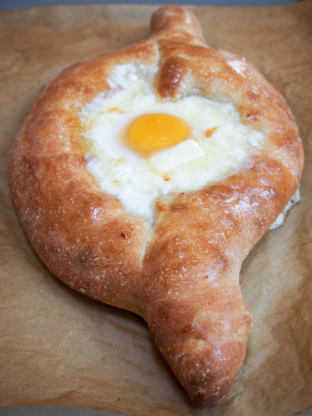 Adjaruli khachapuri Georgian cheese bread with butter added to middle