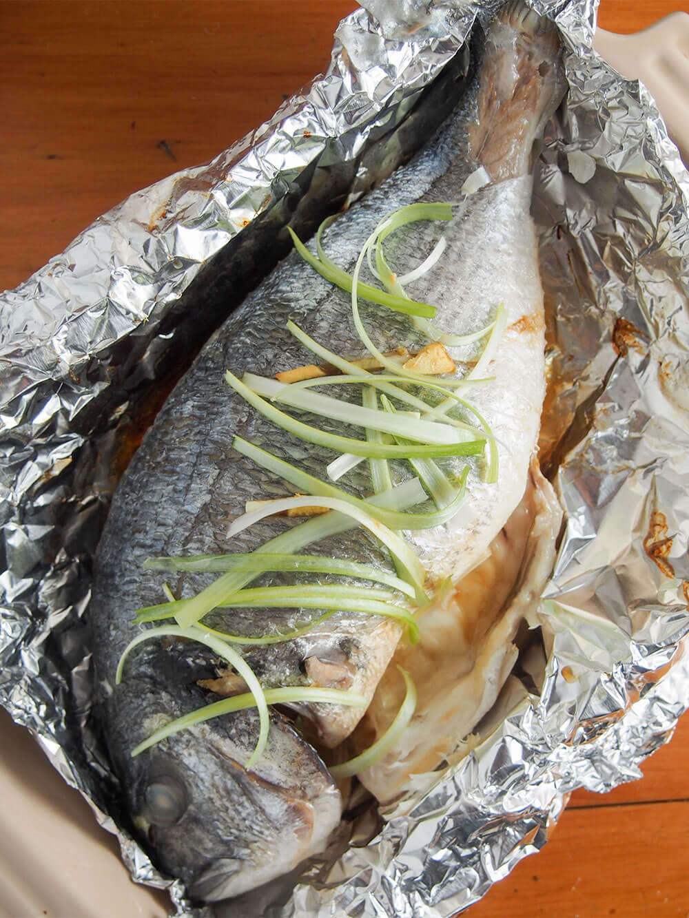 Chinese oven steamed fish - whole fish cooked in foil