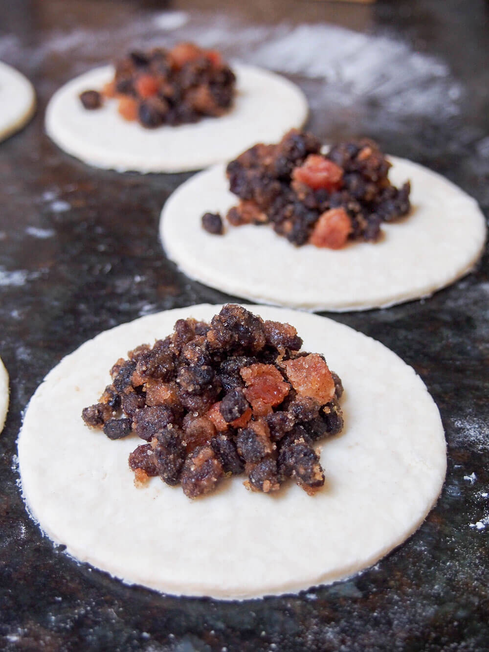 adding filling to Eccles cakes - crisp currant filled pastries