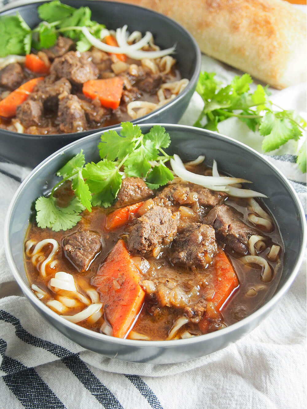 bo kho Vietnamese beef stew - two bowls served over noodles