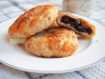 Eccles cakes, British currant pastries, on plate
