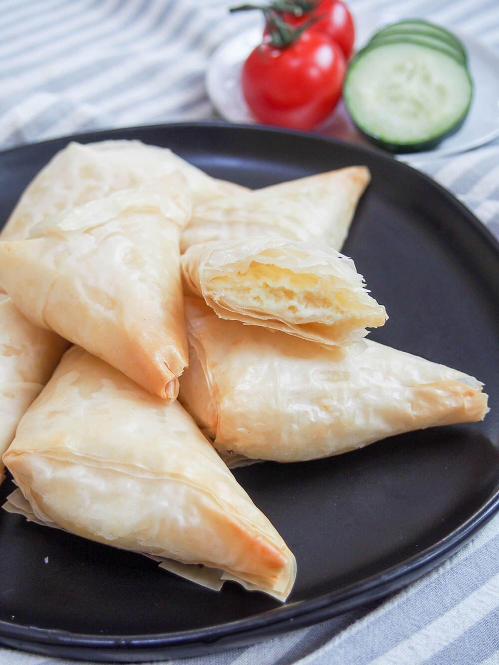 tiropita Greek cheese pastries with one split open