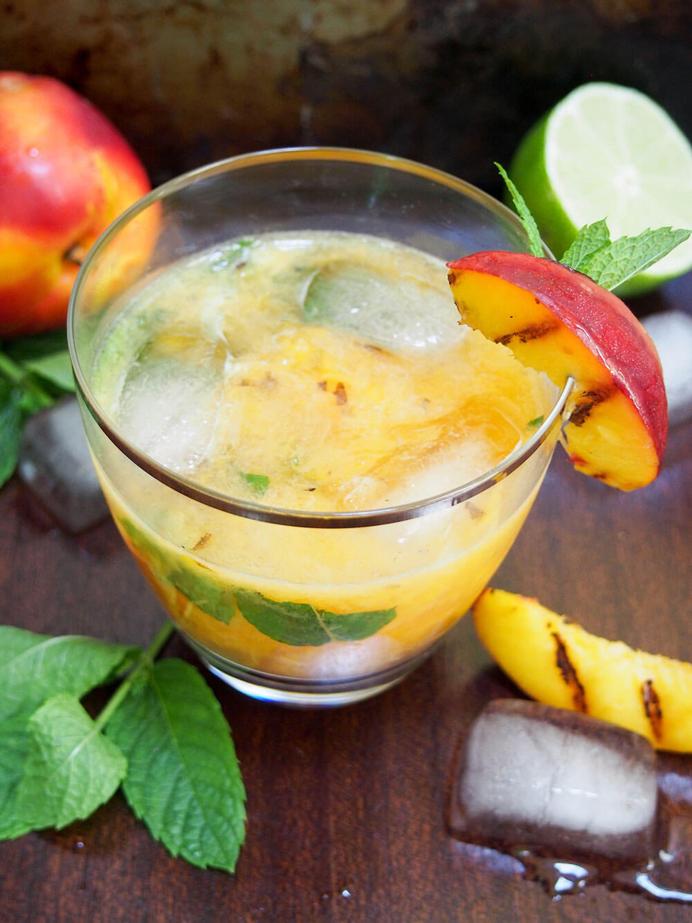 Grilled peach mojito with ice in drink