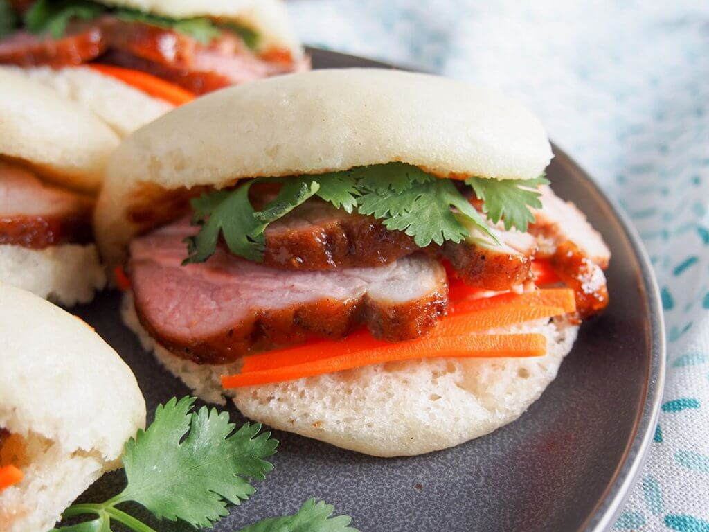 steamed bao buns with pork close up of bun