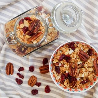 Homemade granola recipe - some in bowl, rest in jar from overhead