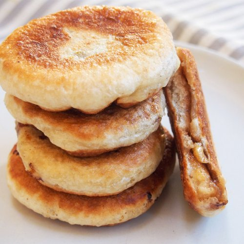 hotteok Korean sweet pancakes in stack with one bitten to side