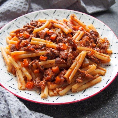 lamb ragu pasta on plate