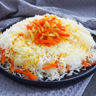 Persian sweet rice (shirin polow) with carrot orange topping