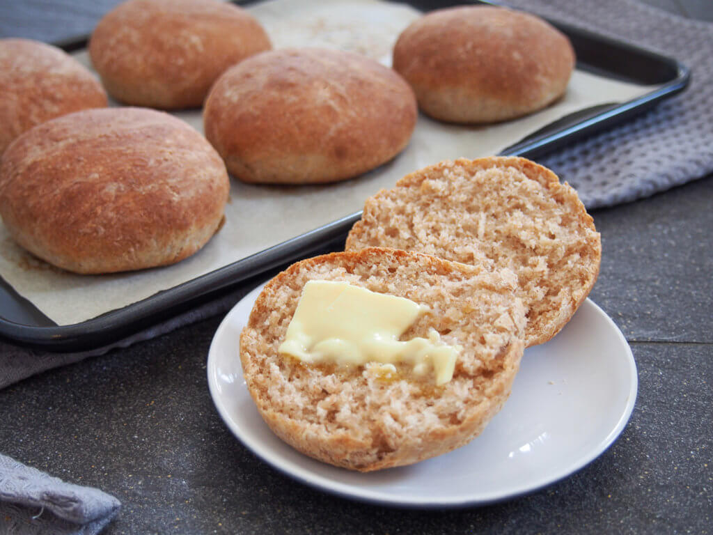 finished bread roll with butter on top and other rolls behind