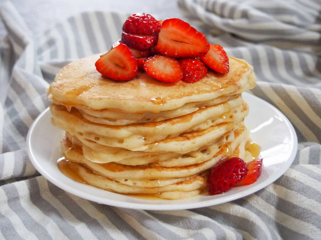 stack of sourdough pancakes with strawberries on top