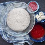 sourdough pizza dough in bowl