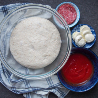 sourdough pizza dough with toppings to side