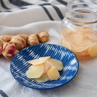 Japanese pickled ginger on small plate with additional in jar to side