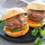 chicken satay burgers on plate
