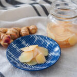 Japanese pickled ginger on plate with jar to side