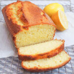 French lemon yogurt cake with slices cut in front of loaf