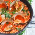bowl of Sardinian fregola with clams close up