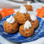 carrot cake energy bites stacked on small plate