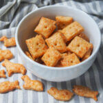 homemade cheese crackers in bowl with animal shapes ones below