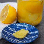preserved lemons with jar behind and piece on plate