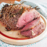 roast lamb with garlic and rosemary studded on top