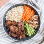 Bowl with beef bulgogi, rice and vegetable sides from above