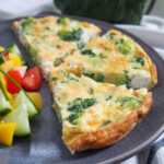 slices of broccoli goat cheese frittata on plate