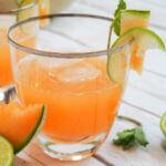 glass of cantaloupe agua fresca from side