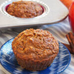 carrot apple muffin on plate with another in tray behind