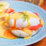 Eggs Royale (smoked salmon eggs Benedict) with yolk oozing into sauce