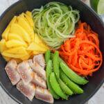 seared tuna and veggie bowl close up