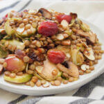 plate of vegan lentil salad with roasted Brussels sprouts