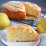 slice of French pear cake in front of rest of cake