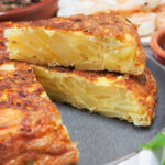 slice of Spanish tortilla sitting on top of rest