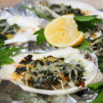 Oysters Rockefeller with lemon slice behind