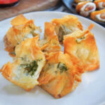 some pesto goat cheese filo parcels on plate