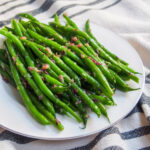 Sautéed French green beans on plate